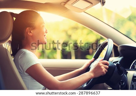 young asian woman driver driving a car,vintage effect - stock photo