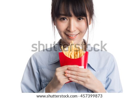 Young asian woman eating french fries, potato fries, isolated on white background - stock photo