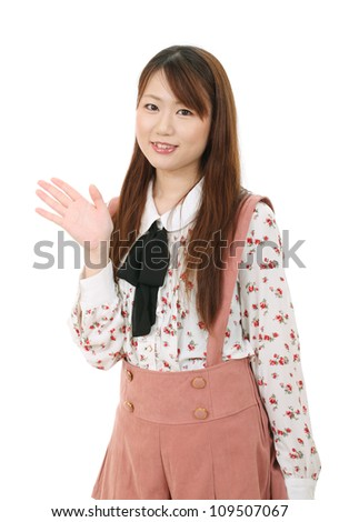 Young asian woman hand showing blank sign - stock photo