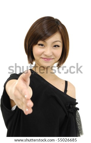 Young asian Woman holding hand out and smiling - stock photo