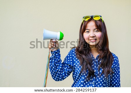 Young asian woman holding megaphone . - stock photo