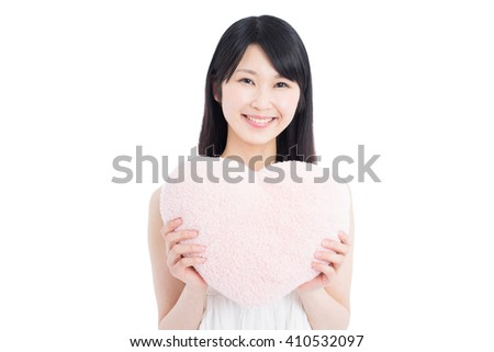 Young Asian woman holding pink heart, isolated on white background - stock photo