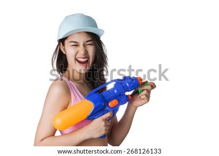 Young Asian woman holding plastic water gun at Songkran festival, Thailand. - stock photo