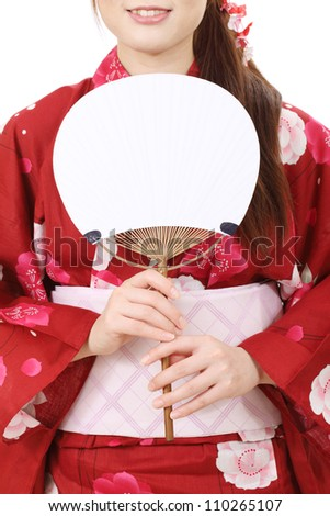 Young asian woman in traditional clothes of kimono with paperfan - stock photo