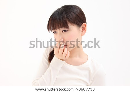 Young Asian woman pinch the nose white background - stock photo