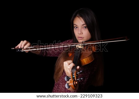 young asian woman playing violin or fiddle - stock photo