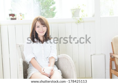 Young asian woman relaxing in the room  - stock photo
