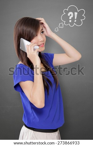 Young Asian woman scratching her head in confusion while talking on cell phone, with comical question and exclamation mark doodles on gray background - stock photo