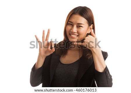 Young Asian woman show with phone gesture and OK sign  isolated on white background. - stock photo