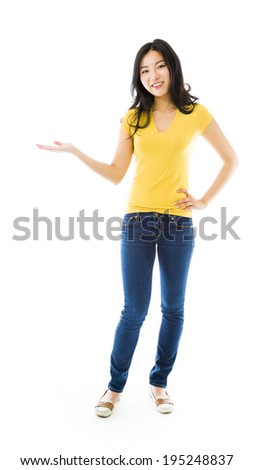 Young Asian woman showing product with open hand palm - stock photo