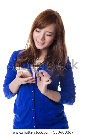 Young asian woman using smart phone mobile on white background - stock photo