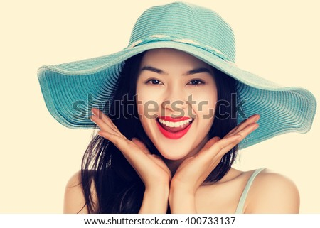 Young Asian woman wearing blue straw hat with expression of surprise, vintage tone style. - stock photo