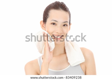 Young Asian woman wiping sweat - stock photo