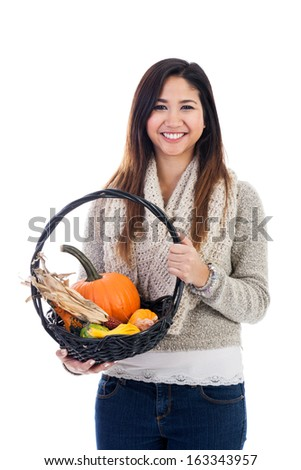 Young Asian woman with basket of pumpkins,gourds and indian corn isolated on a white background - stock photo