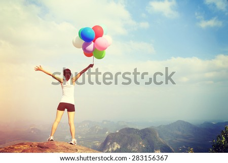 young asian woman with colored balloons  - stock photo