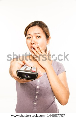 young asian woman with remote control - stock photo