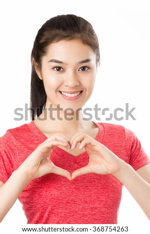 Young Asian woman with smiley face making heart shape by her hands isolated on white background.  - stock photo