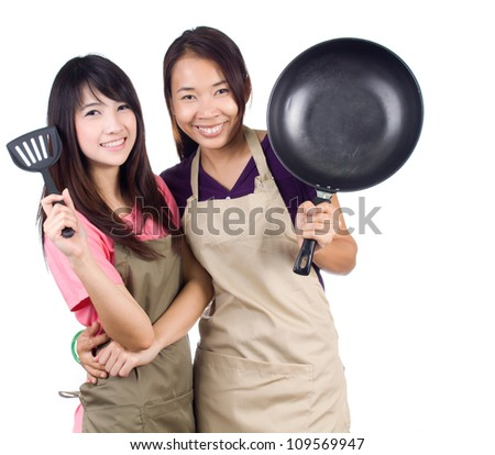 Young asian women housewife are hugging on white background - stock photo