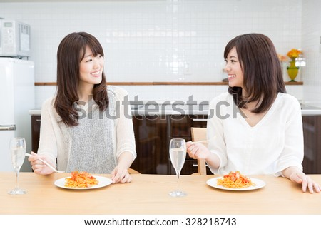 young asian women lifestyle image in the kitchen - stock photo