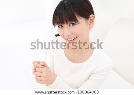 Young Asian women to massage the finger - stock photo