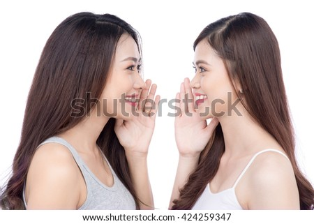 Young asian young woman friends gossiping some secret over white  - stock photo