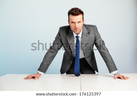 Young assertive professional looking at camera - stock photo