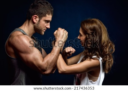 young athletic  couple  in the gym - stock photo