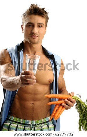 Young athletic man having glass of water - stock photo