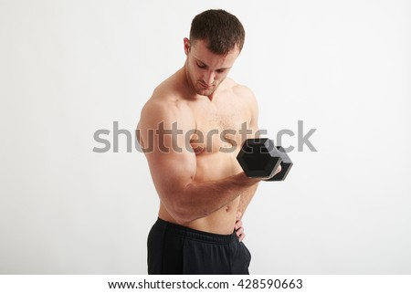 Young athletic man with bare chest is lifting a dumbbell isolated on white background - stock photo