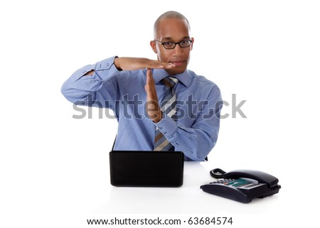 Young attractive African American businessman in office sitting at desk with a laptop and telephone, indicating timeout . Studio shot. White background. - stock photo