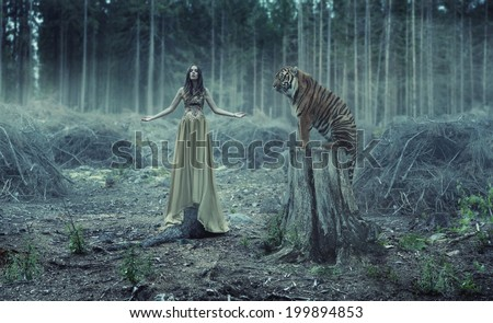 Young attractive and sensuality woman with tiger - stock photo