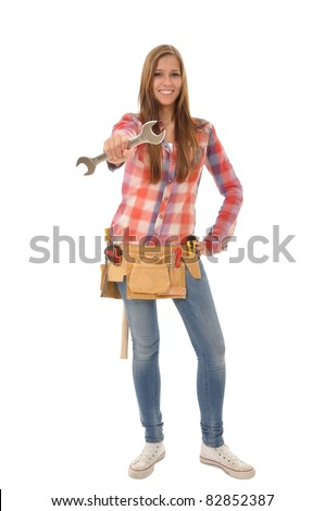 Young attractive artisan proudly displays her wrench - stock photo