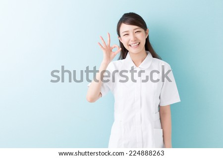 Young attractive asian nurse of the smile - stock photo