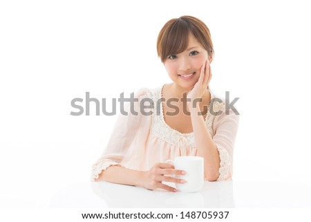 young attractive asian woman who takes a drink - stock photo