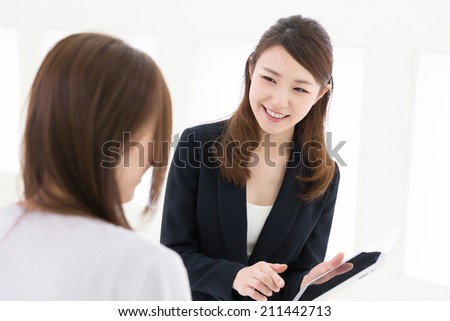 young attractive asian woman who waits on customers - stock photo