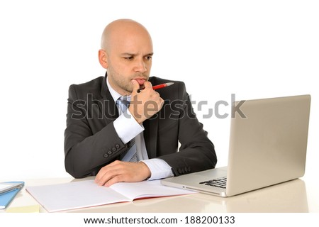 young attractive bald business man working with computer thinking and concentrated - stock photo