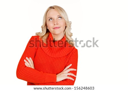 Young attractive blonde woman thinking - stock photo