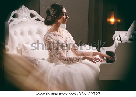 Young attractive bride. Portrait of beautiful bride. Wedding dress. Wedding decoration. Fashion art photo. - stock photo