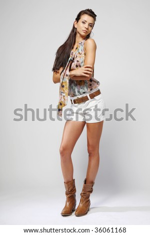 Young attractive brunette fashion model. - stock photo