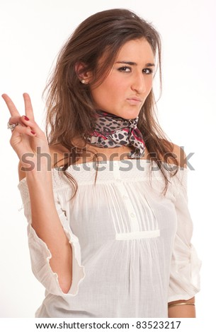 Young attractive brunette sticking out two fingers - stock photo