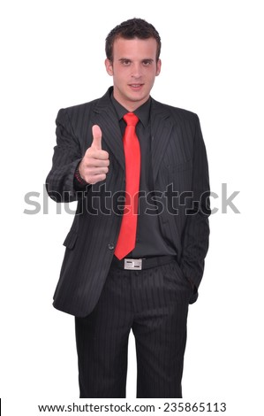 Young attractive busienssman thumbs up - stock photo