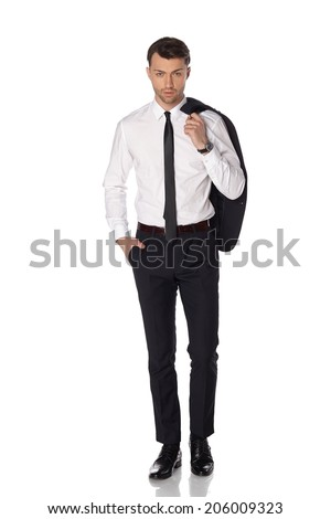 Young attractive business man in black suite on white background. - stock photo