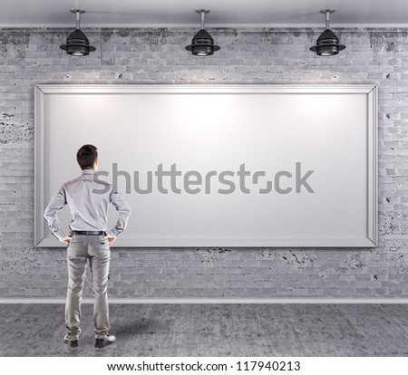 young attractive business man in front of a vintage old blank wall - stock photo