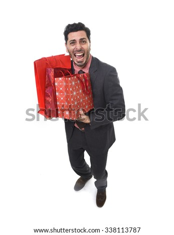 young attractive business man in stress holding lot of shopping bags looking tired bored and worried after expending too much money on gifts and presents - stock photo