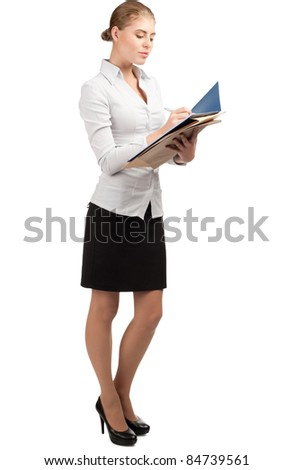 Young attractive business woman holding folder with documents and writing, isolated on white background - stock photo