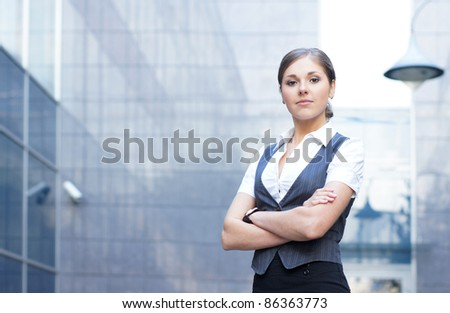 Young attractive business woman over modern background - stock photo