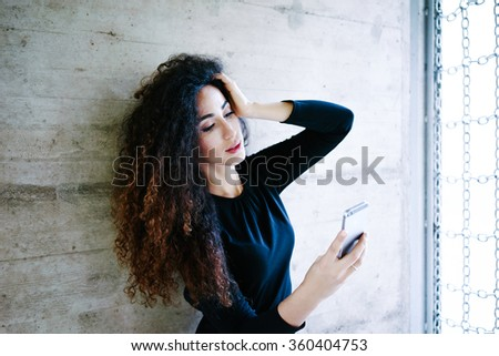 young attractive business woman take a self portrait with her smart phone.Gorgeous young woman photographing herself using her mobile phone.Caucasian female taking selfie with her smart phone outside. - stock photo