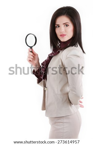 Young attractive business woman with a magnifying glass - stock photo