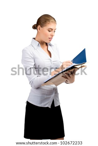 Young attractive business woman with documents writing, isolated on white background - stock photo