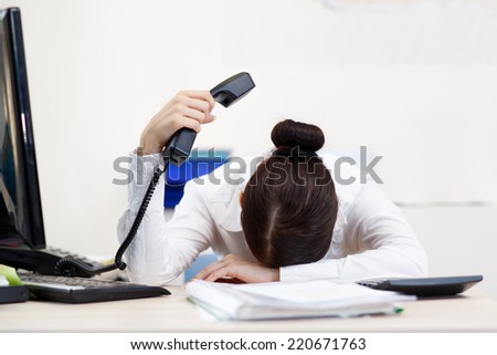 Young attractive business woman with phone in hand - stock photo